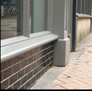 21 Sadler Gate glazed brick stall riser and following repainting