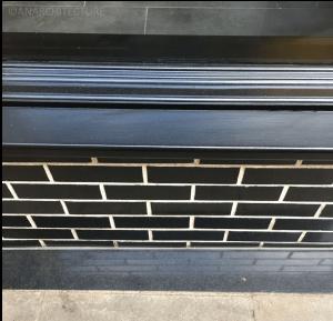 27 Wardwick timber sill and glazed brick stall riser