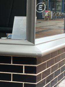 Corner detailing and glazed stall riser